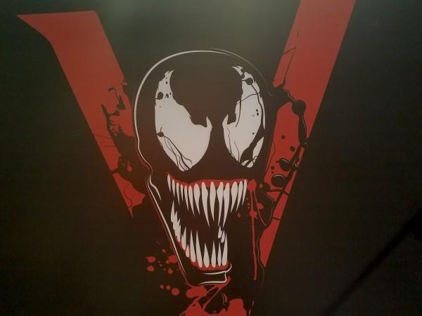 Venom logo y slogan