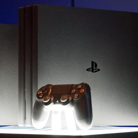 The PlayStation 4 Slim, back, and PlayStation 4 Pro, front.